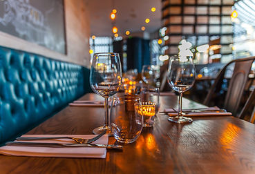 Restaurant table with glasses and cutlery laid out