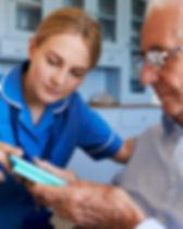 nurse-helping-senior-man-to-organize-med