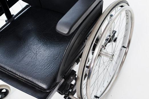 overhead-view-wheelchair-white-backdrop.