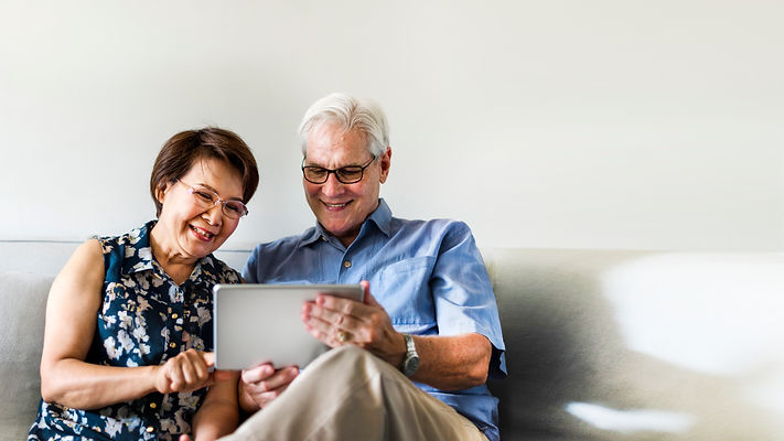 senior-couple-using-digital-device-livin
