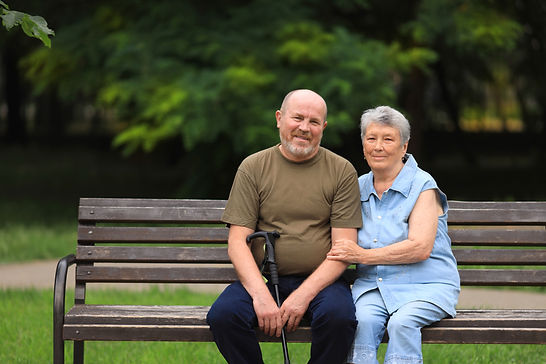 happy-elderly-man-disabled-woman-sit-ben