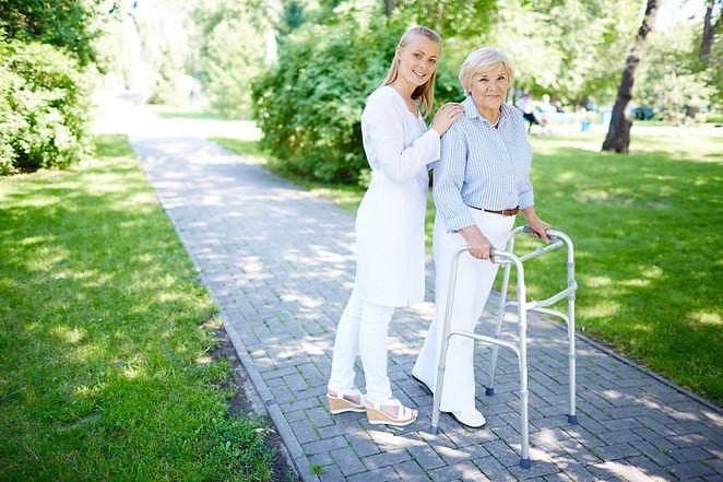 nurse-helping-senior-woman-use-walking-f