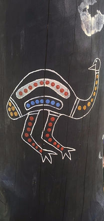 Indigenous painting of an emu on a wooden pole at Culburra Beach Preschool