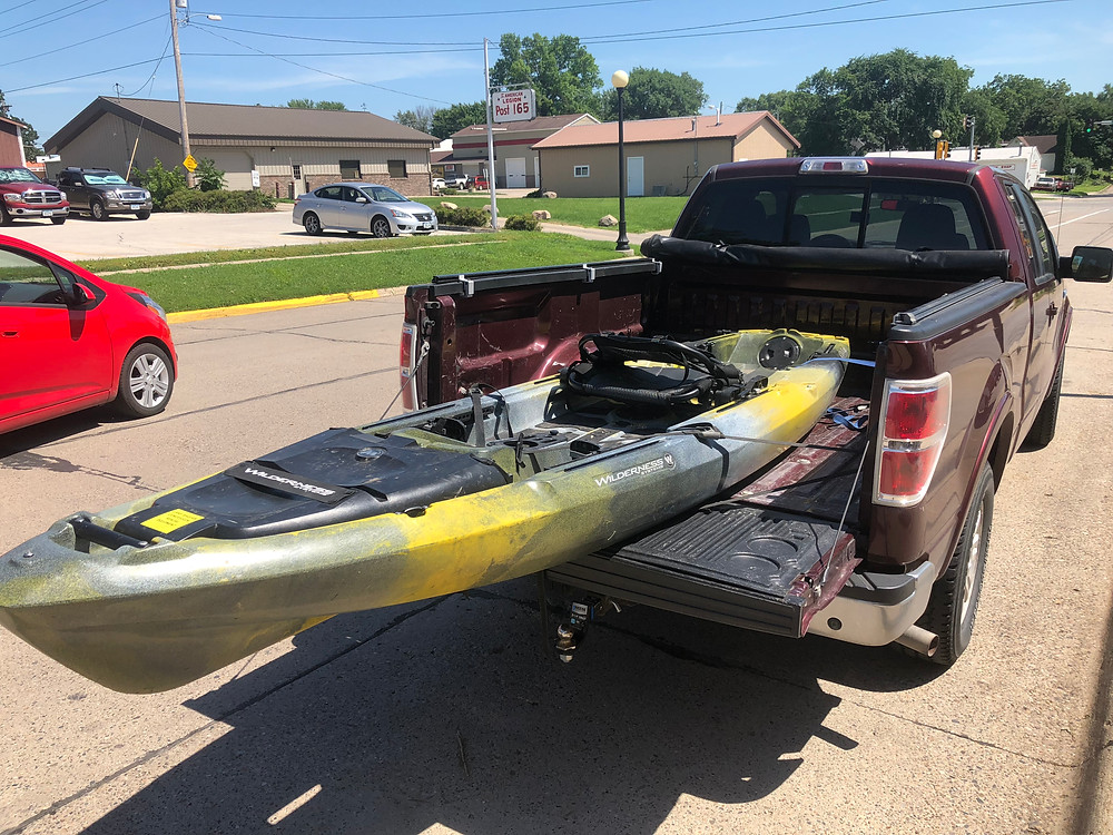 Yellow/black Kayak in truck bed
