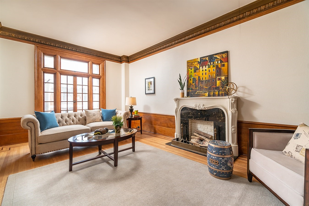 In the Living room, the wainscotting draws the eyes up to the ornate cove molding