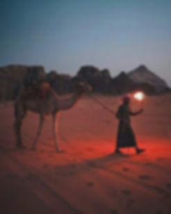 Bedouin with camel in the desert Wadi Rum