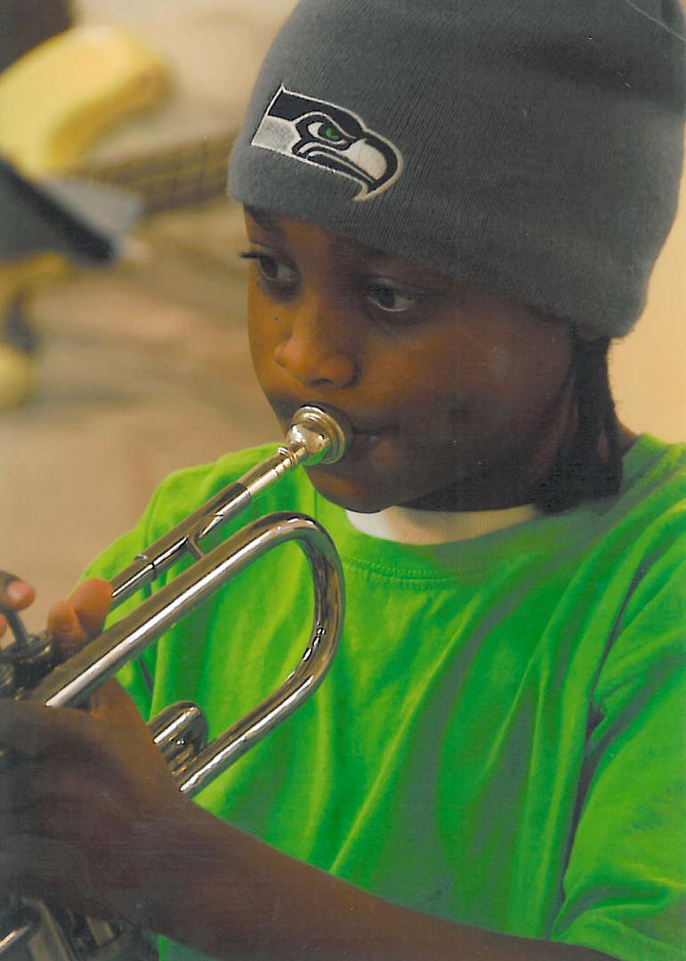 Olu Playing Trumpet