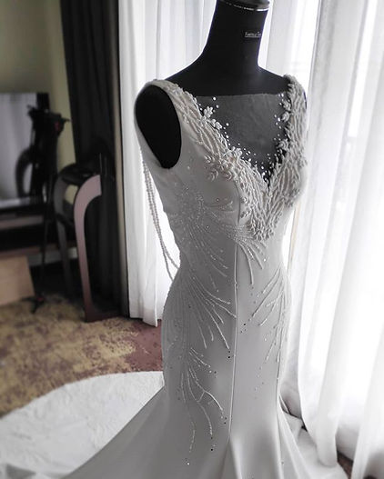 Pearl's wedding gown with fully beaded c