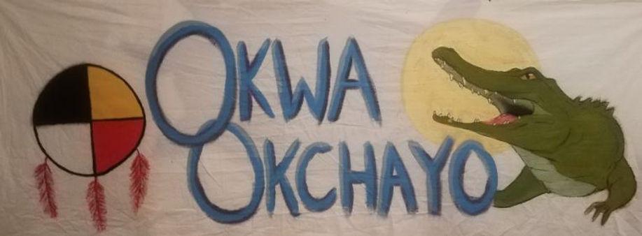 okwa banner.JPG