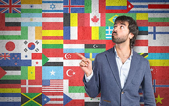 Businessman thinking over flags backgrou