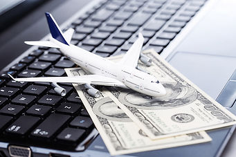 Aircraft and banknotes above laptop.jpg