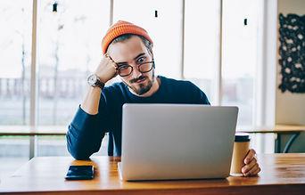 Shocked male freelancer amazed from rece
