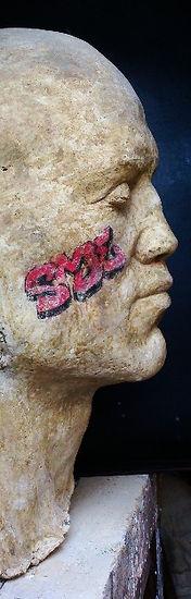 Marc Bodie Sculptor Sculpture, Male Head cast in concrete. Title Secret Means of Escape, part of Praiah Head Series. Graffiti on face.