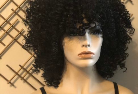 Black curly sewn wig