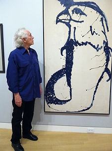 MM in front of one of his paintings at a