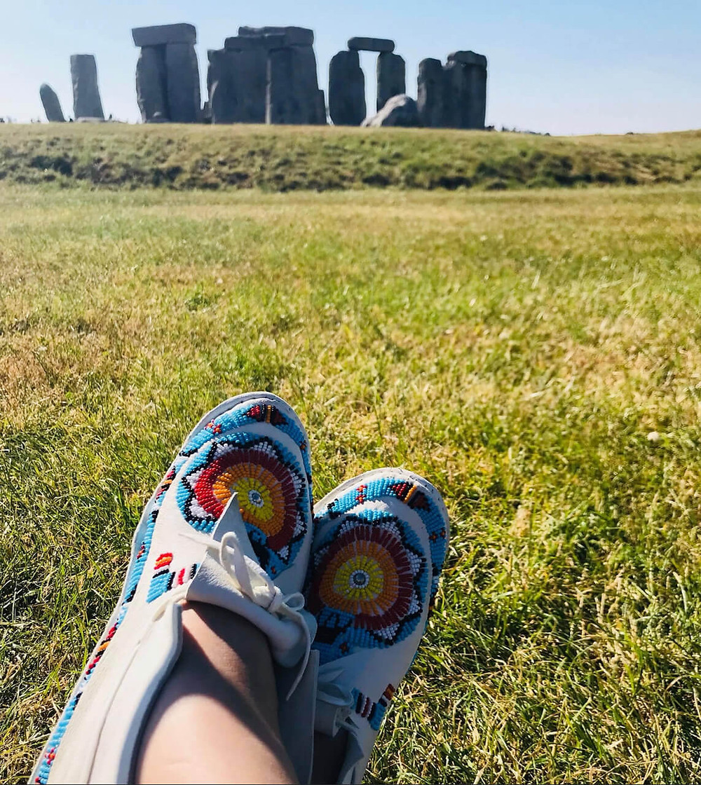 Sitting down by Stone Henge by LeAndra Nephin