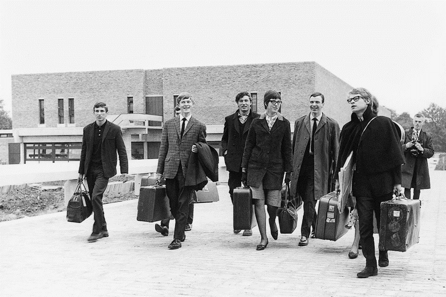 The first Kent students cross Eliot footbridge after arriving on campus in 1965