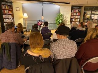 Angus Rorison playing guitar at his book reading at Waterstone's Canterbury