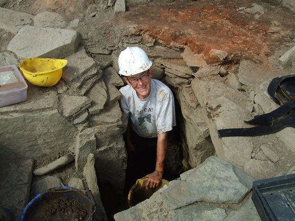 Tour leader Caz Mamwell of Okney Acaeology Tours digging at Swandro