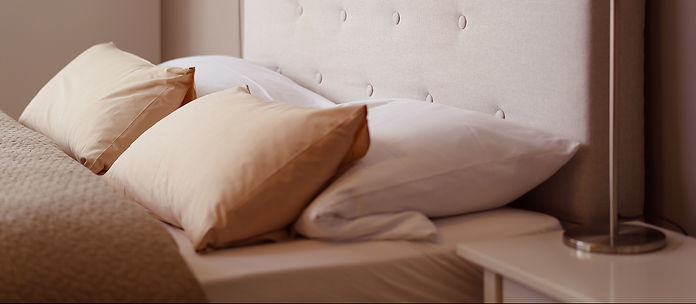 Bedroom close-up of bed with pillows_cro