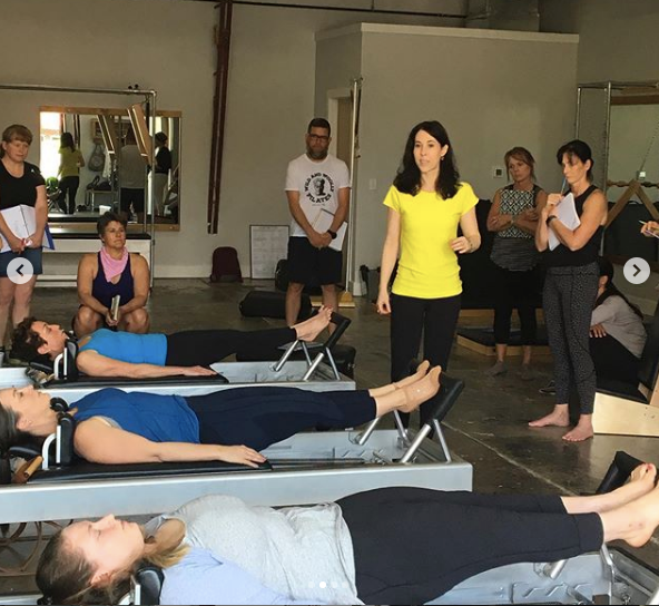 There I am on the bottom of the picture doing footwork on the reformer. MeJo is in the yellow shirt.  Credit: Voltage Pilates-  Instagram