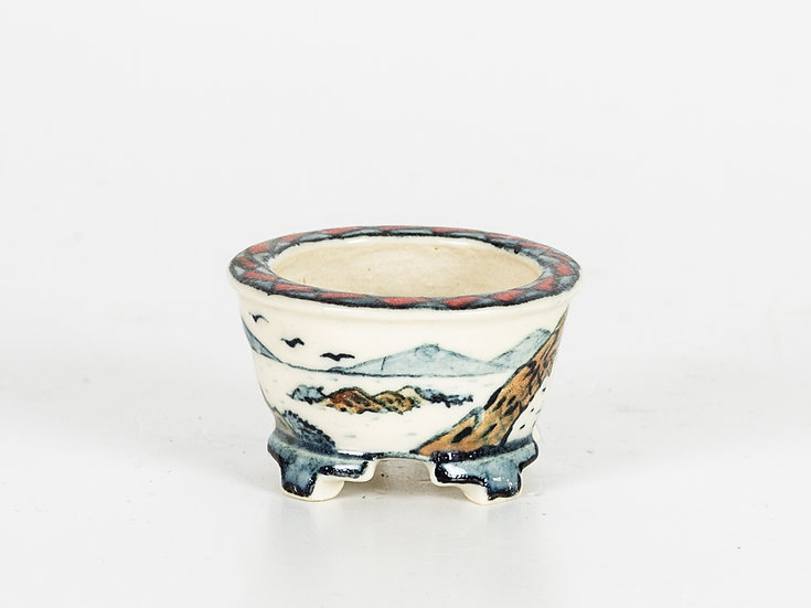 A Round Hand Painted Pot