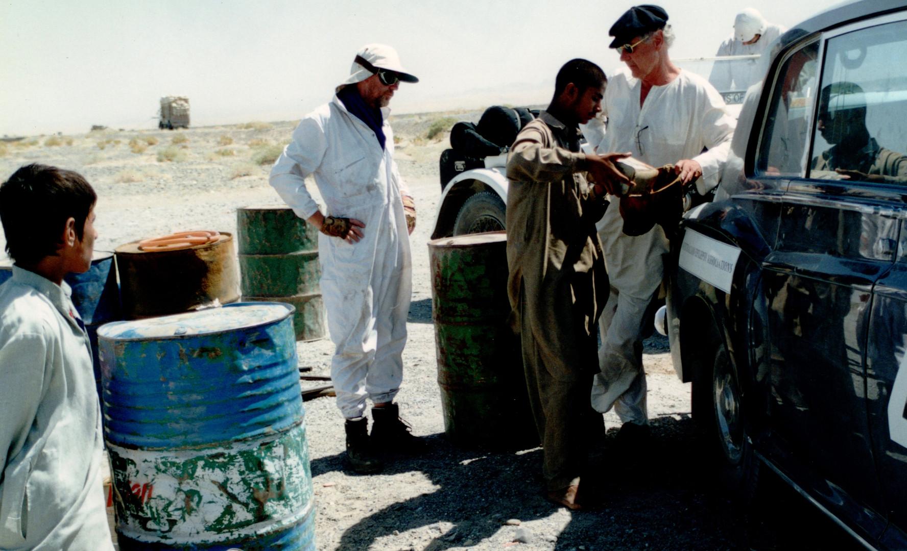 20 P2P loading petrol in Pakistan desert near Irani border.
