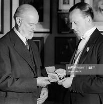Receiving his OBE