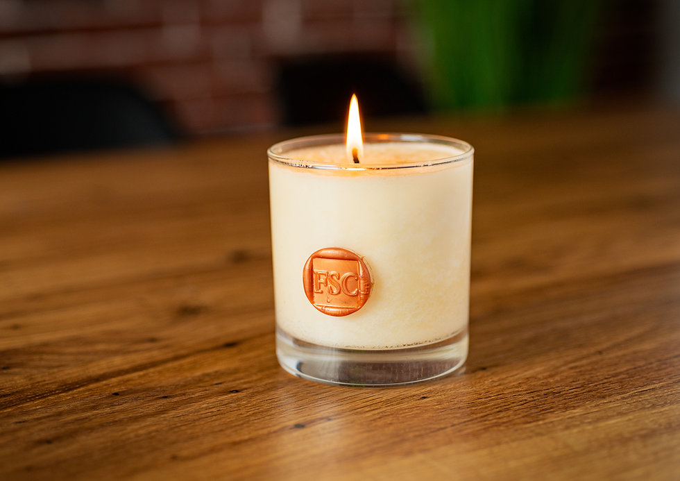 burning candle with wax seal branding