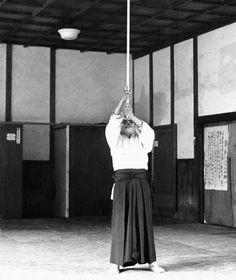 O-Sensei demonstratesuniting heaven and earth, manifesting aiki with his jo, while standing on the floating bridge. Heaven (Fu) - Man (Mi) - Earth (Hi)