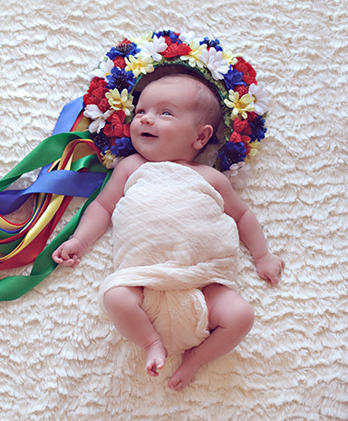 smiling baby with Ukrainian wreath