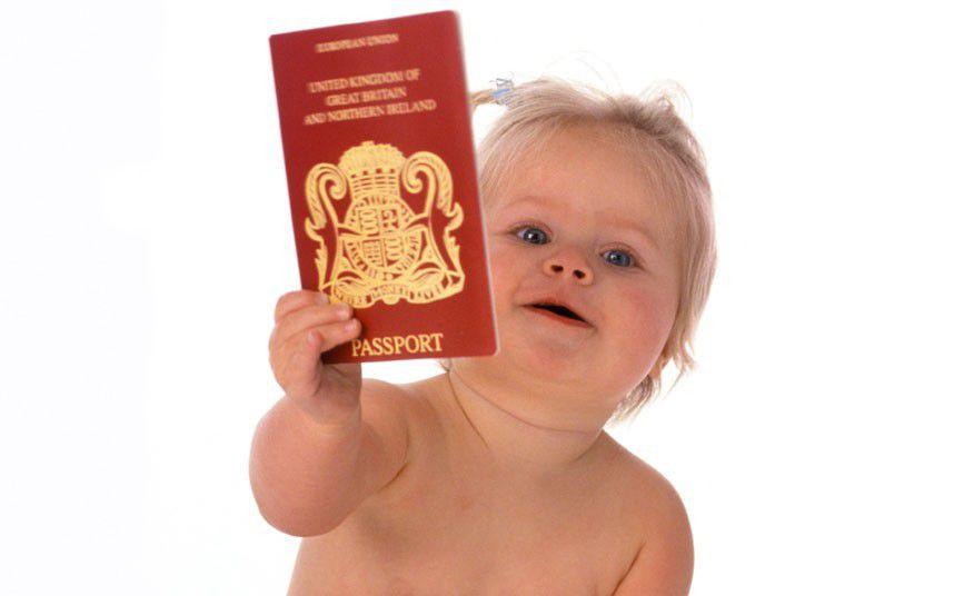baby with a British passport in hand