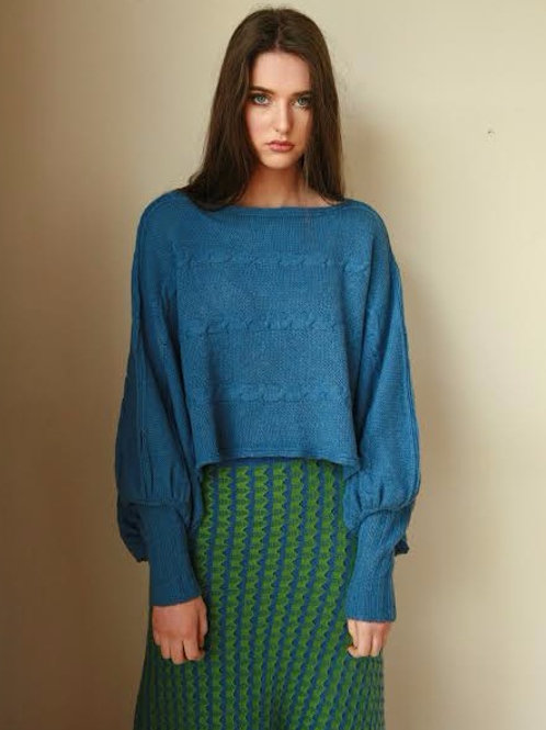 Cornish Blue Cable draped poncho style jumper with gathered sleeves and fitted rib cuffs