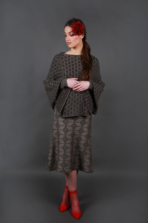 Loose fitting waist length poncho style jumper with fitted ribbed cuffs