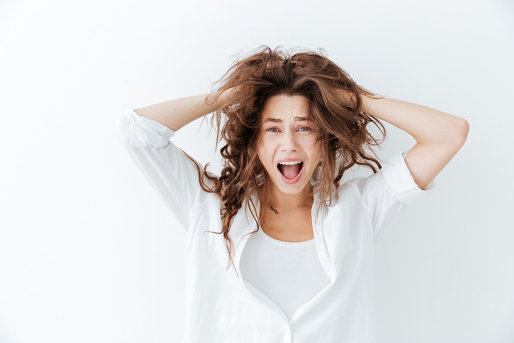 Brunette woman with messy hair.