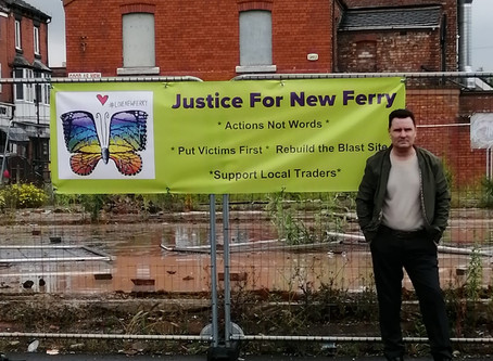 Justice for New Ferry banner hung up at blast site
