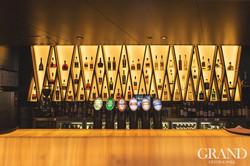 Alcoholic spirit display behind bar