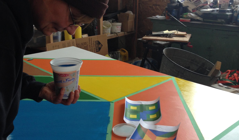 Brenda painting her Barn Quilt