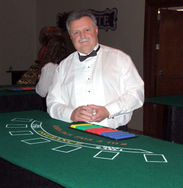 Blackjack dealer ready for guests at a Corporate Casino Party in Nashville, TN.