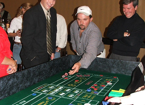 Roll the dice!  Guests play craps at a Casino Party in Nashville, TN.