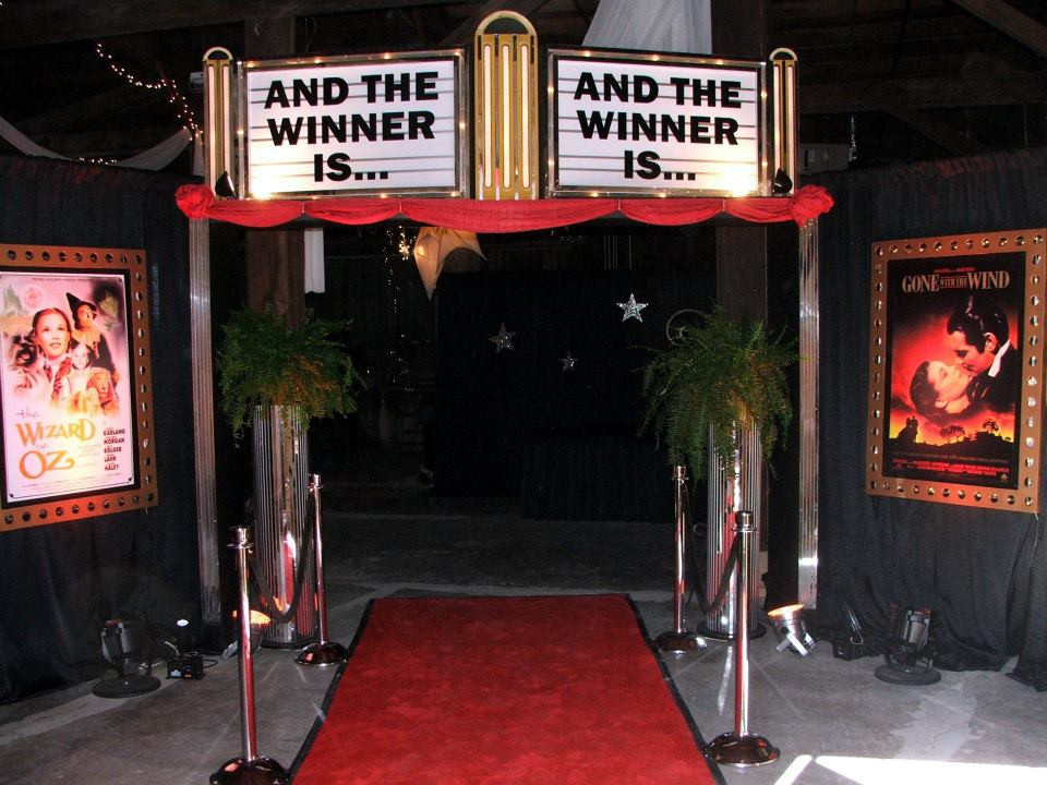Theater Marquee Entrance Decor with Red Carpet, Black Draping, and Movie Posters
