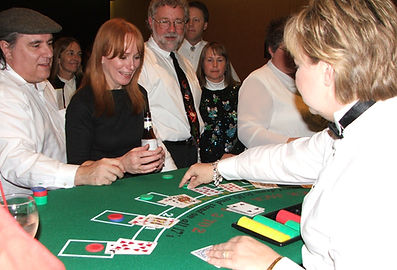 Casino Party guests playing Blackjack.
