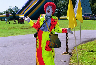 Colorful Clown greeting guests at a Company Picnic