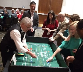Guests playing Craps at a Nashville Convention Casino Party