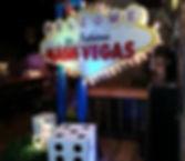 "Casino Entrance Decor with ""Welcome to NashVegas"" sign"