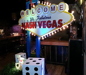 "Casino Entrance Decor with ""Welcome to NashVegas"" sign"