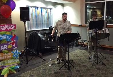 Live musical entertainment at a tropical themed event.