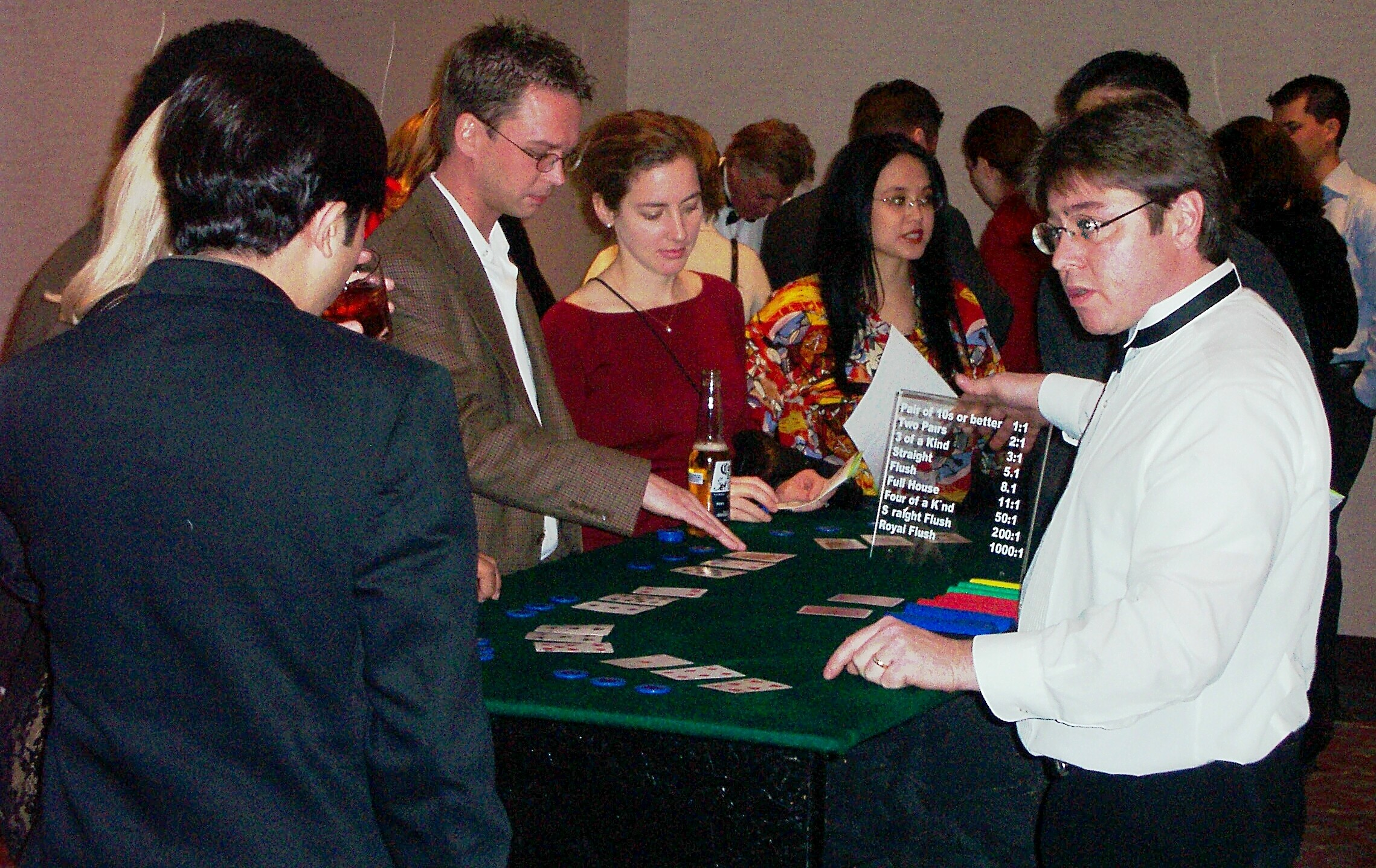 Casino Party guests learning to play