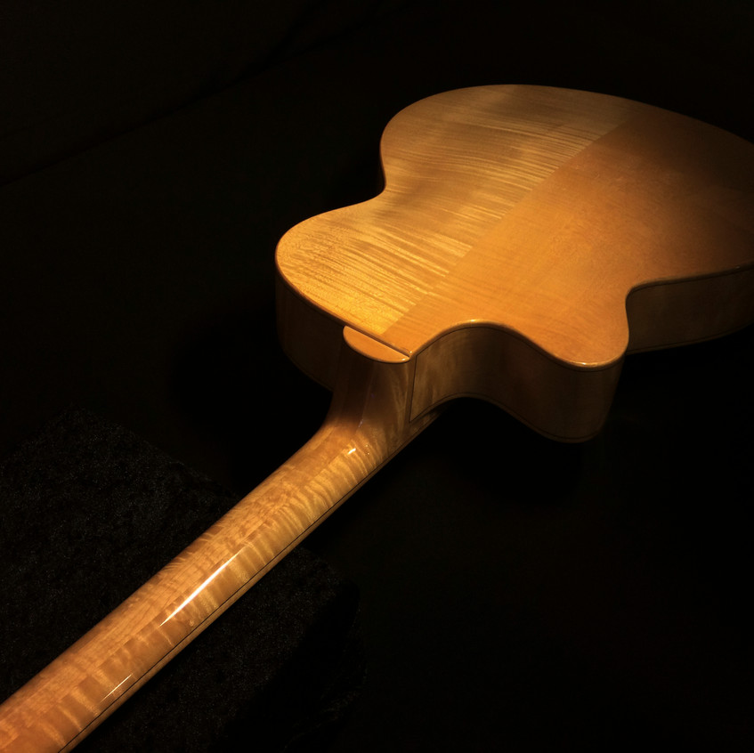 HAND CARVED FLAME MAPLE BACK & SIDES