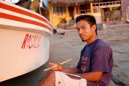 Luis paints his boat, La Manzanilla, 2008